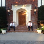 Jeremy and Paul relax in front of the manor.
